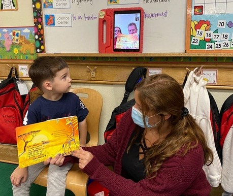 grandmother and child reading story to classmates