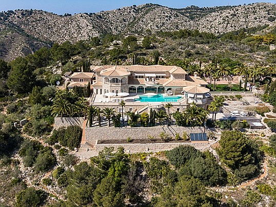 Llucmajor, Mallorca - Premium villa complex with pool in green surroundings of Mallorca in front of a mountainous hill