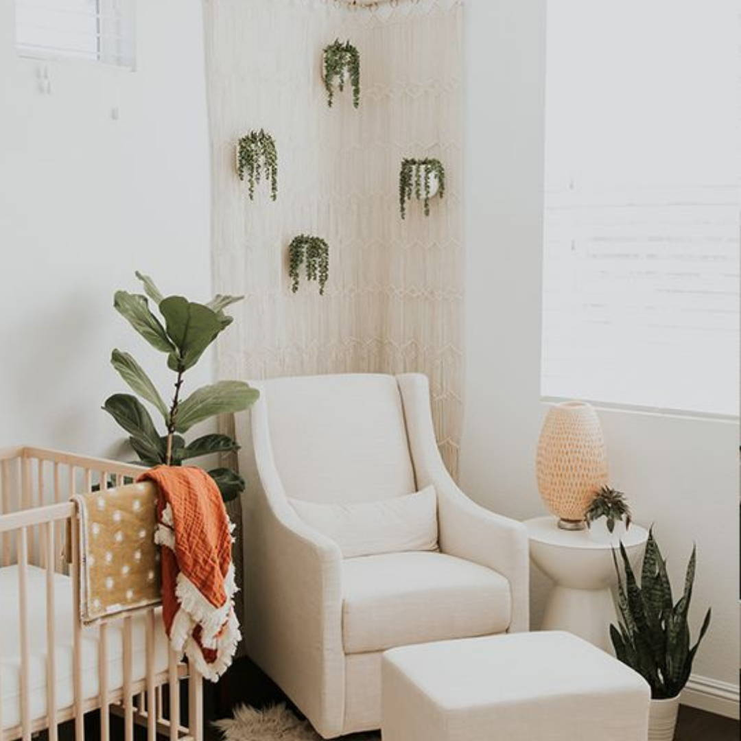 Hanging and pot indoor plants with rocking chair for nursery decor