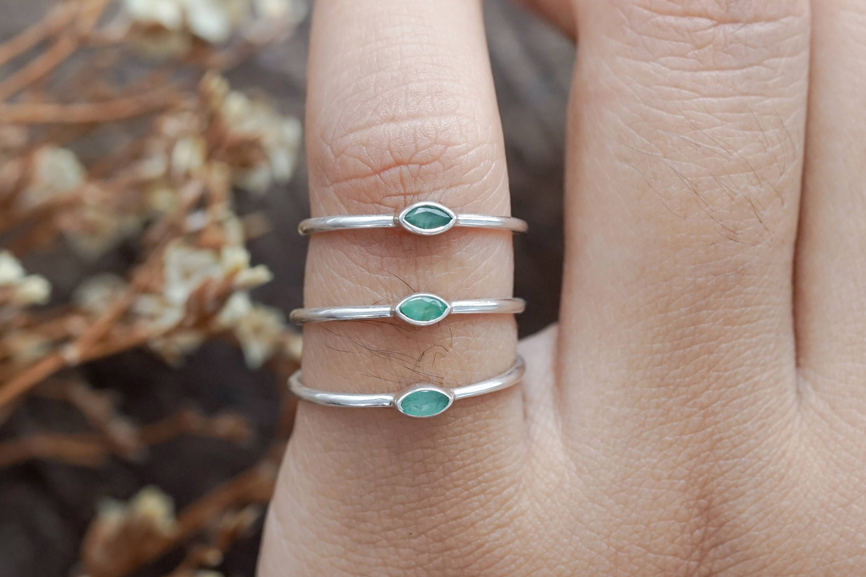 Dainty silver stacking ring with emeralds