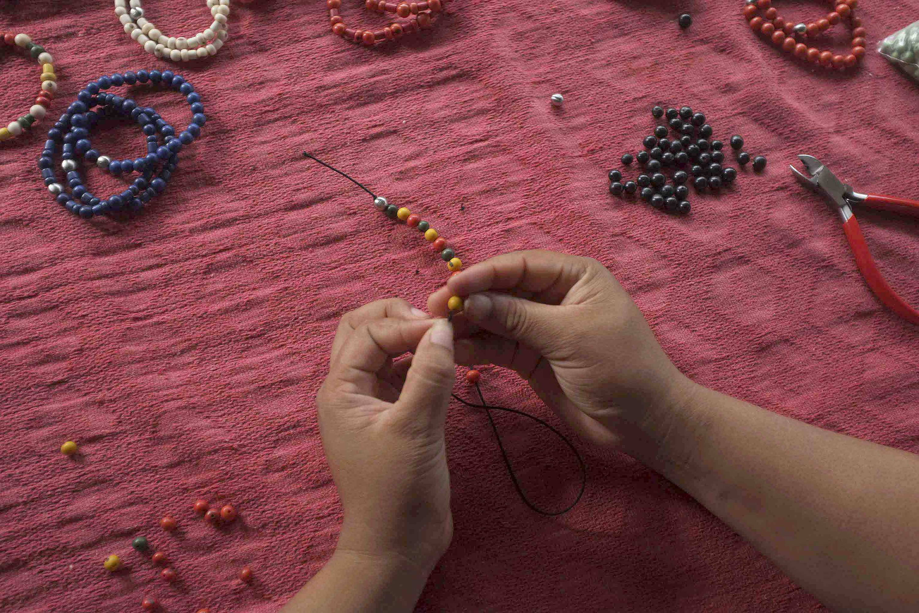 beads being hand-threaded