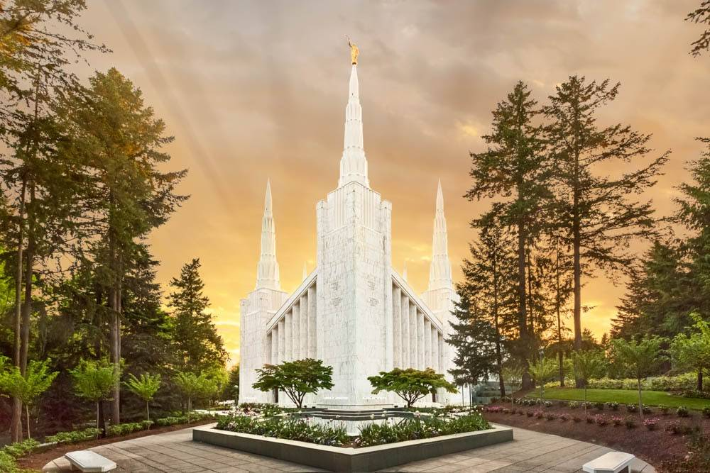 LDS art photo of the Portland Oregon Temple in front of a glowing, orange sky.
