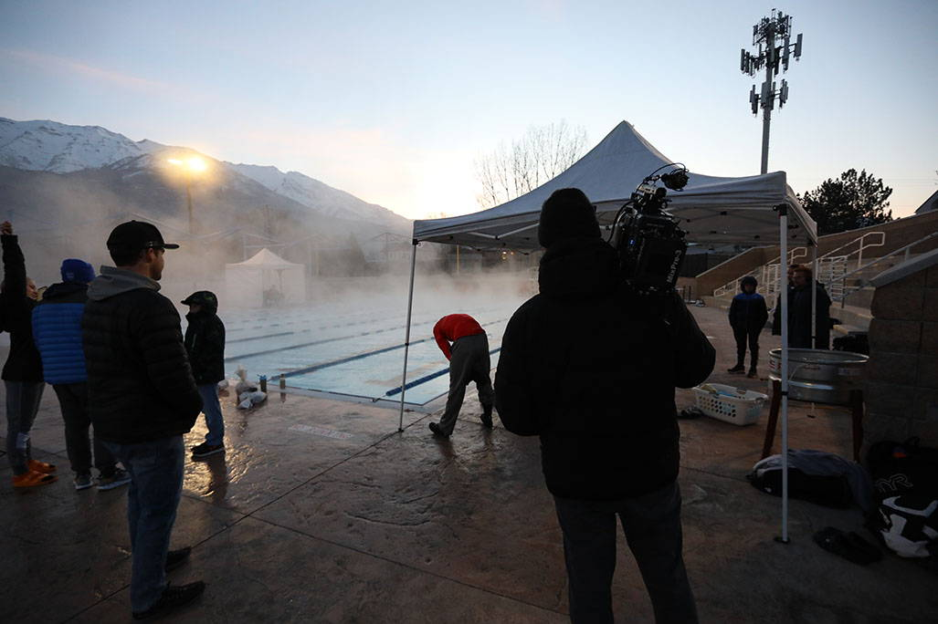 Foggy pool with small crowd