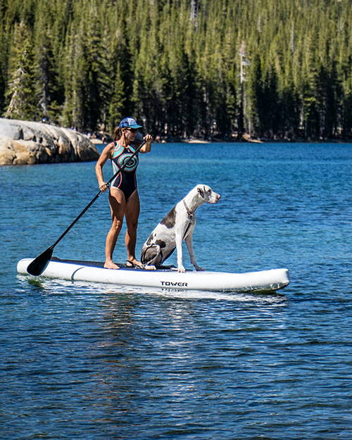 Woman SUPing with her big dog