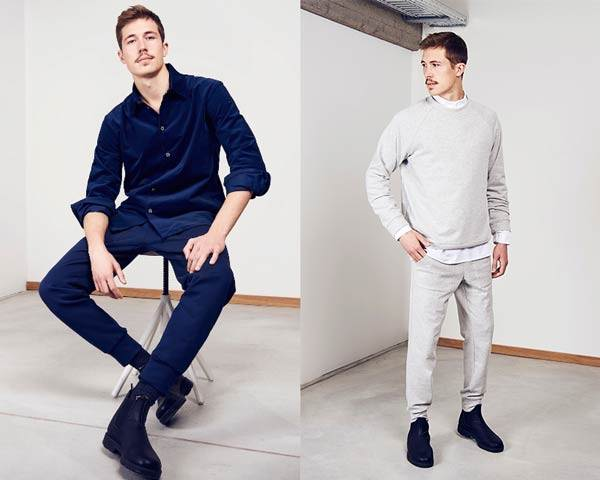 Man wearing organic cotton navy shirt with navy sweatpants and boots and man wearing light grey matching organic cotton sweatpants and sweatshirt with a white shirt underneath