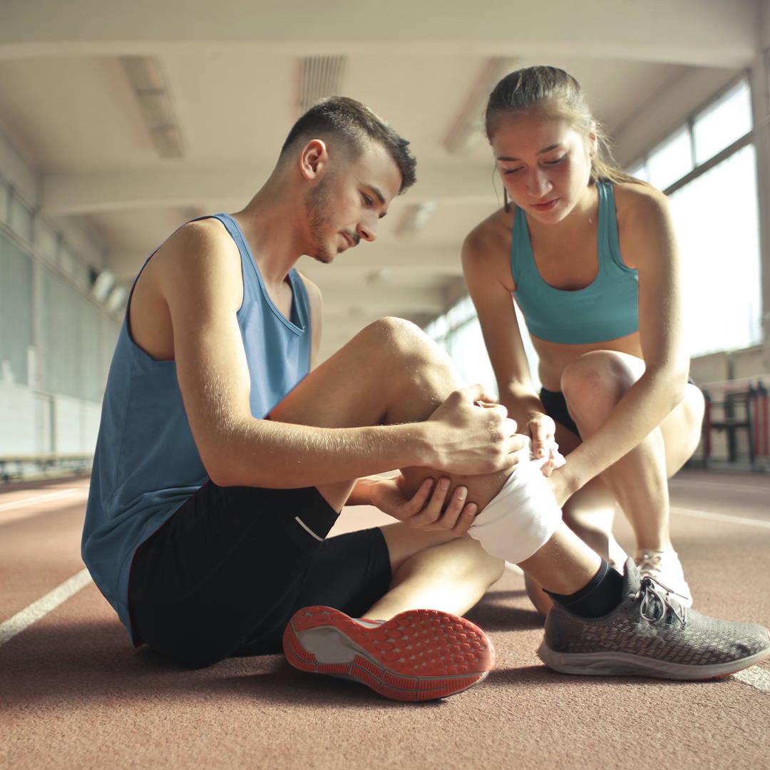 women helping man with sore shins