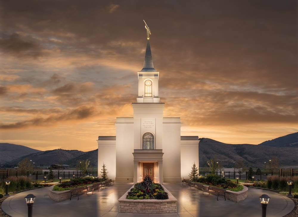 LDS art photo of the Star Valley Wyoming Temple against an evening sky and mountains.