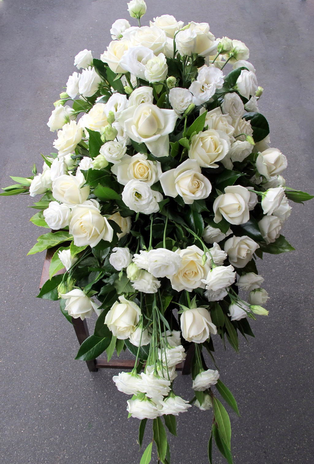 Funerals beautiful casket arrangements estelle flowers dunedin nz we can deliver sympathy bouquets in dunedin and surrounding areas please contact us or order through our online shop izmirmasajfo