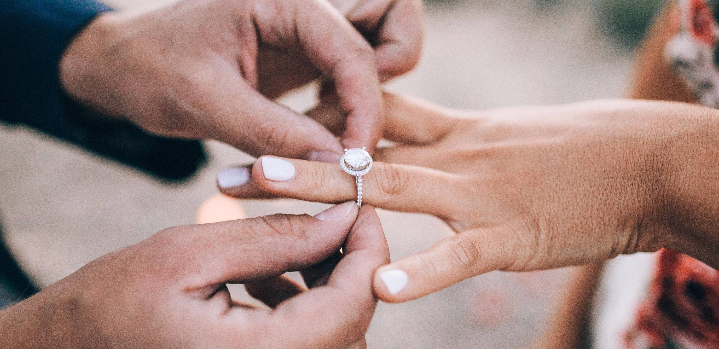 should i buy a moissanite or diamond engagement ring