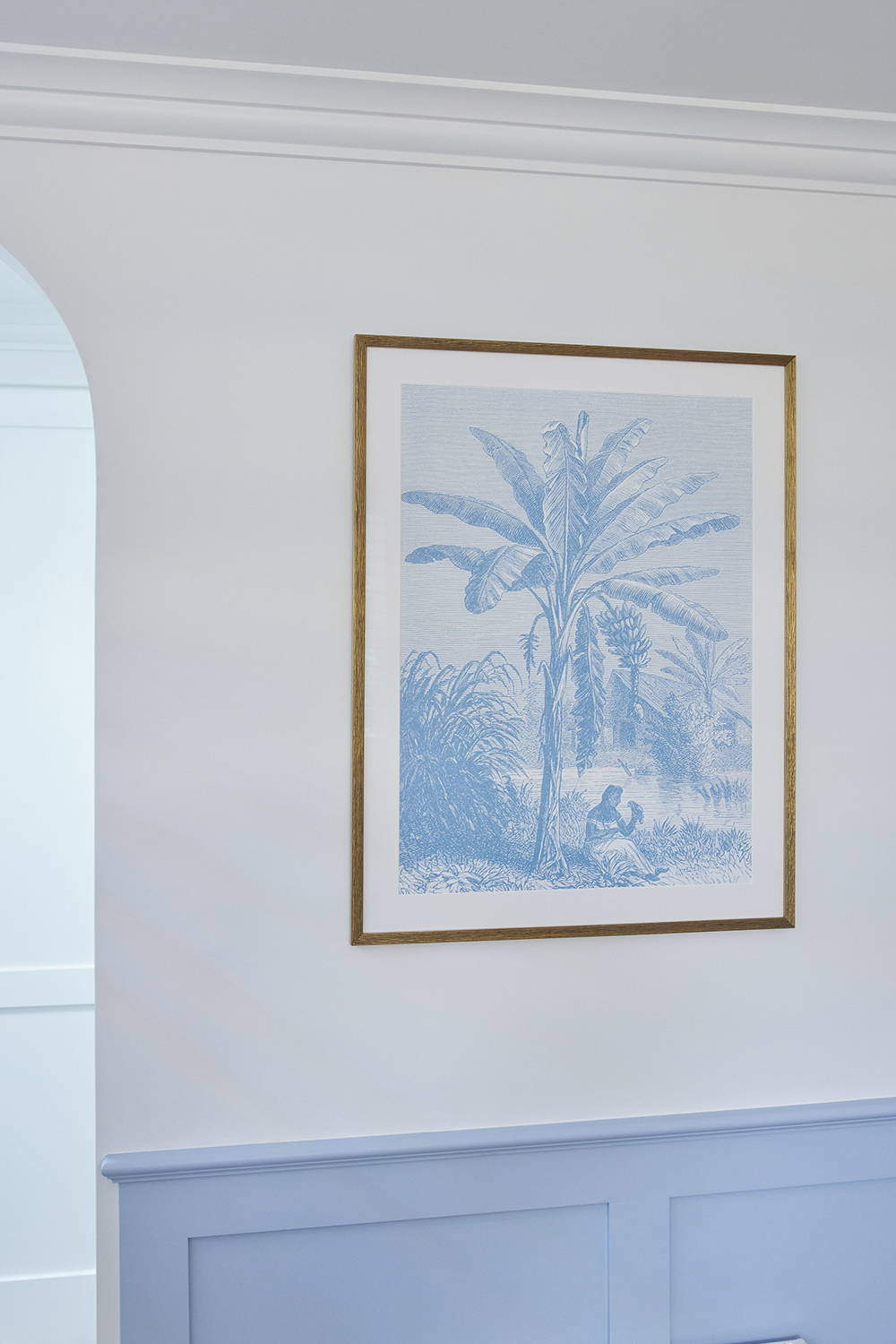Framed Print in Kirsty and Jesse's The Block Guest Bedroom - A Hampton's bedroom interior with palm tree artwork framed in gold