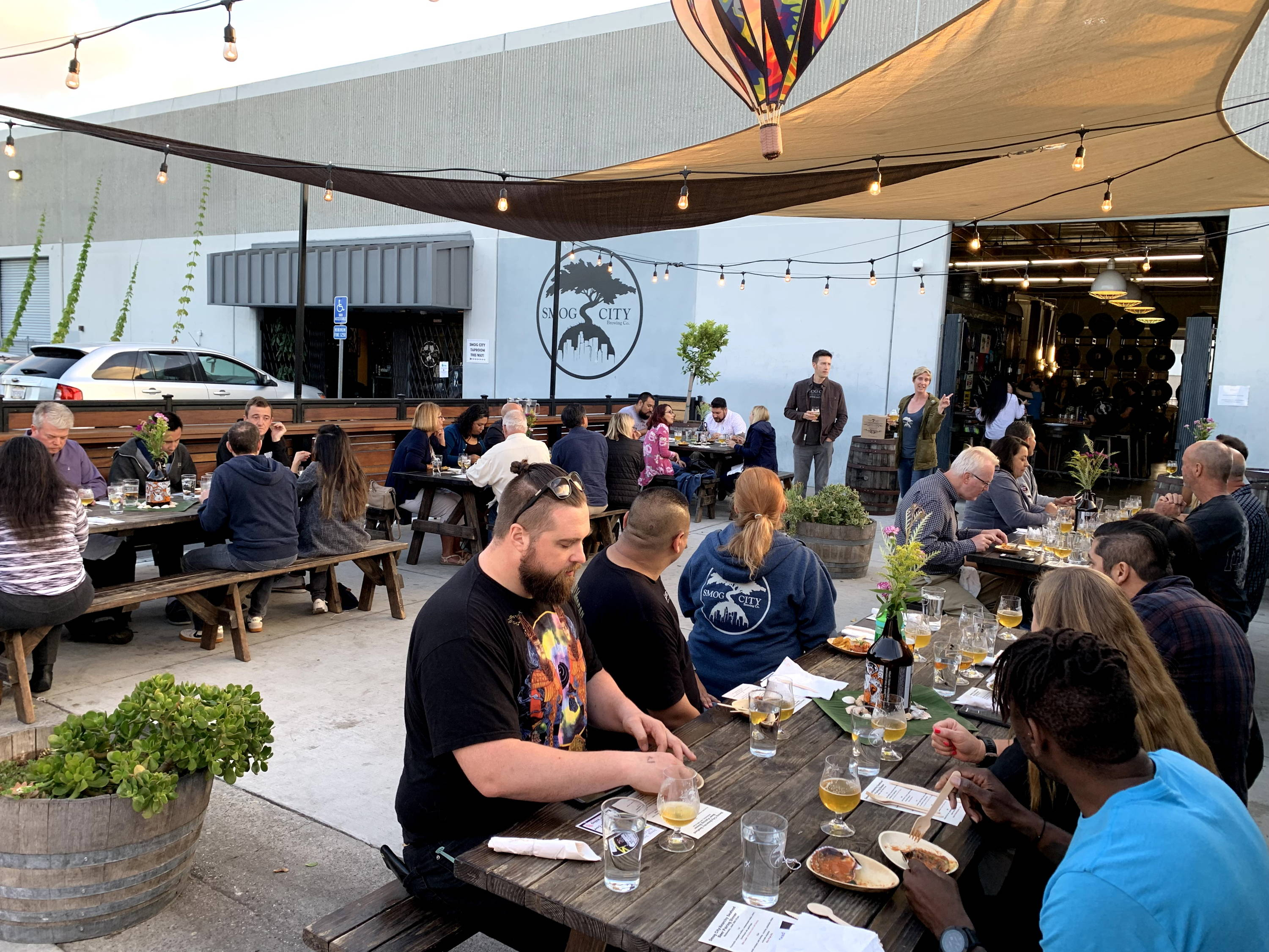 a view of the patio at the Brewery and Taproom. Guests are enjoying an informative beer dinner.