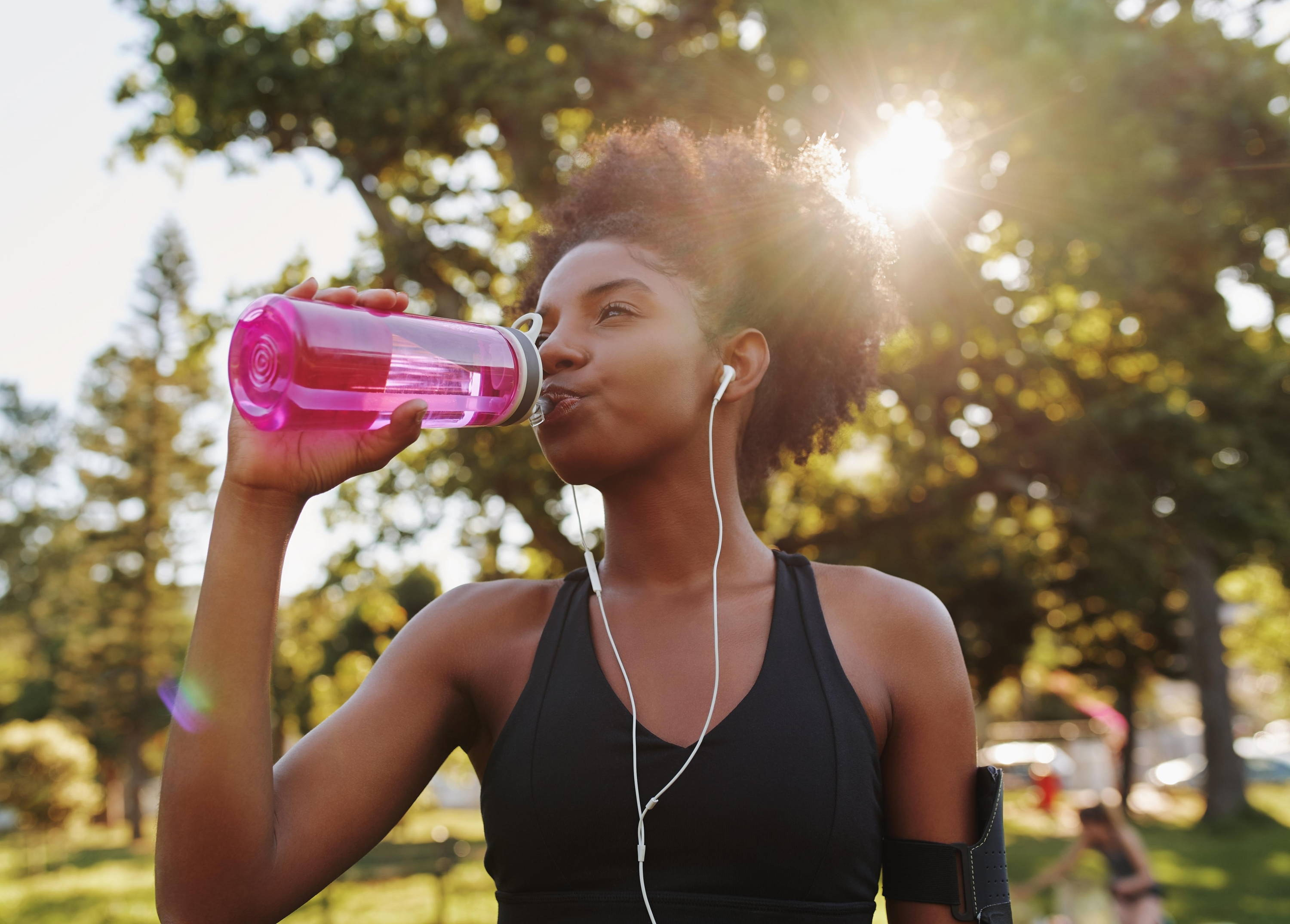 woman drinking water exercise daily feeling good positive productive