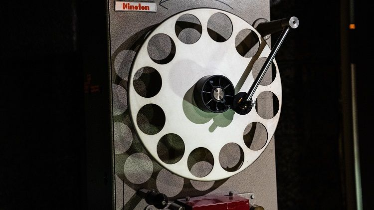 A silver projector reel.