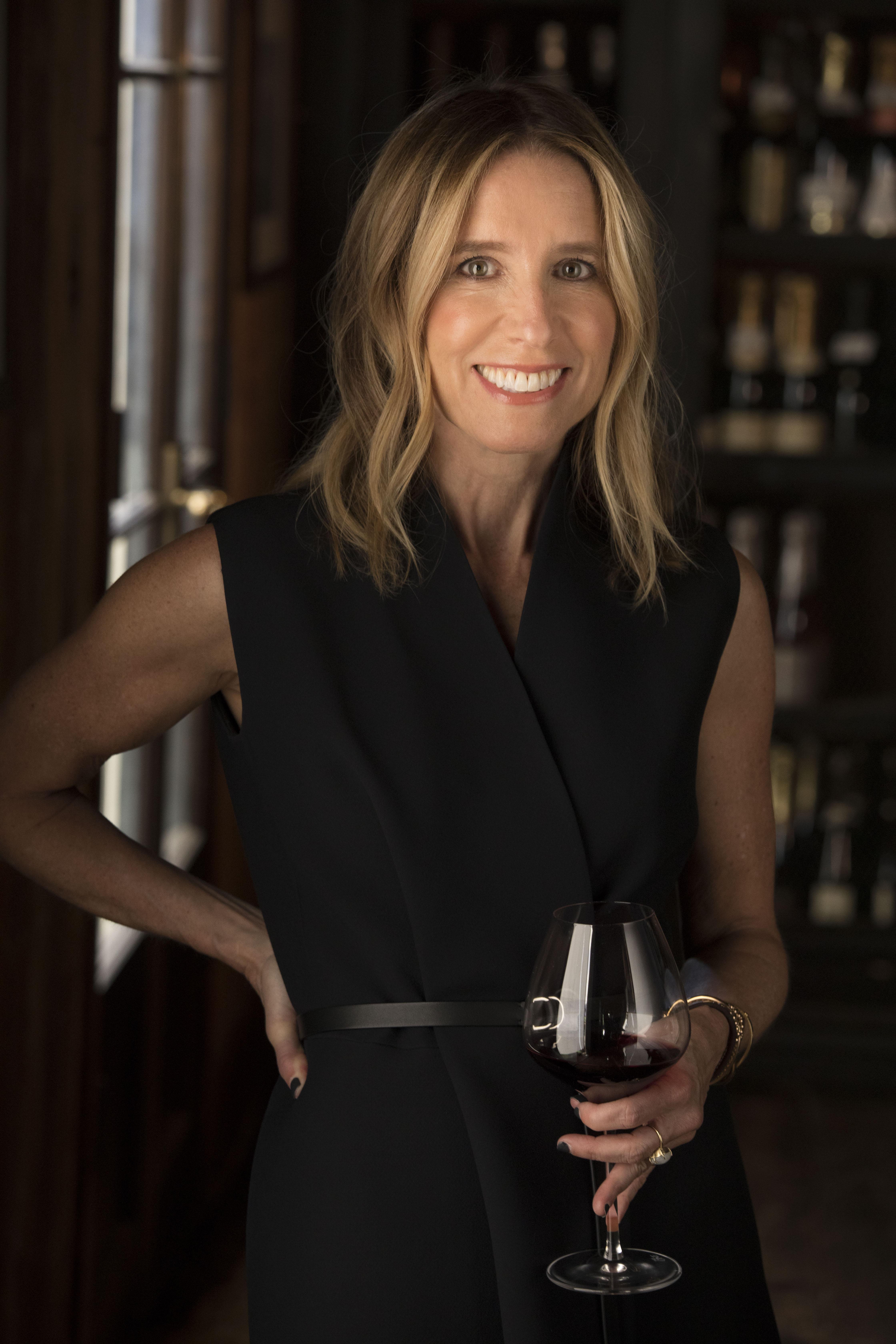 Caroline Styne with a glass of wine