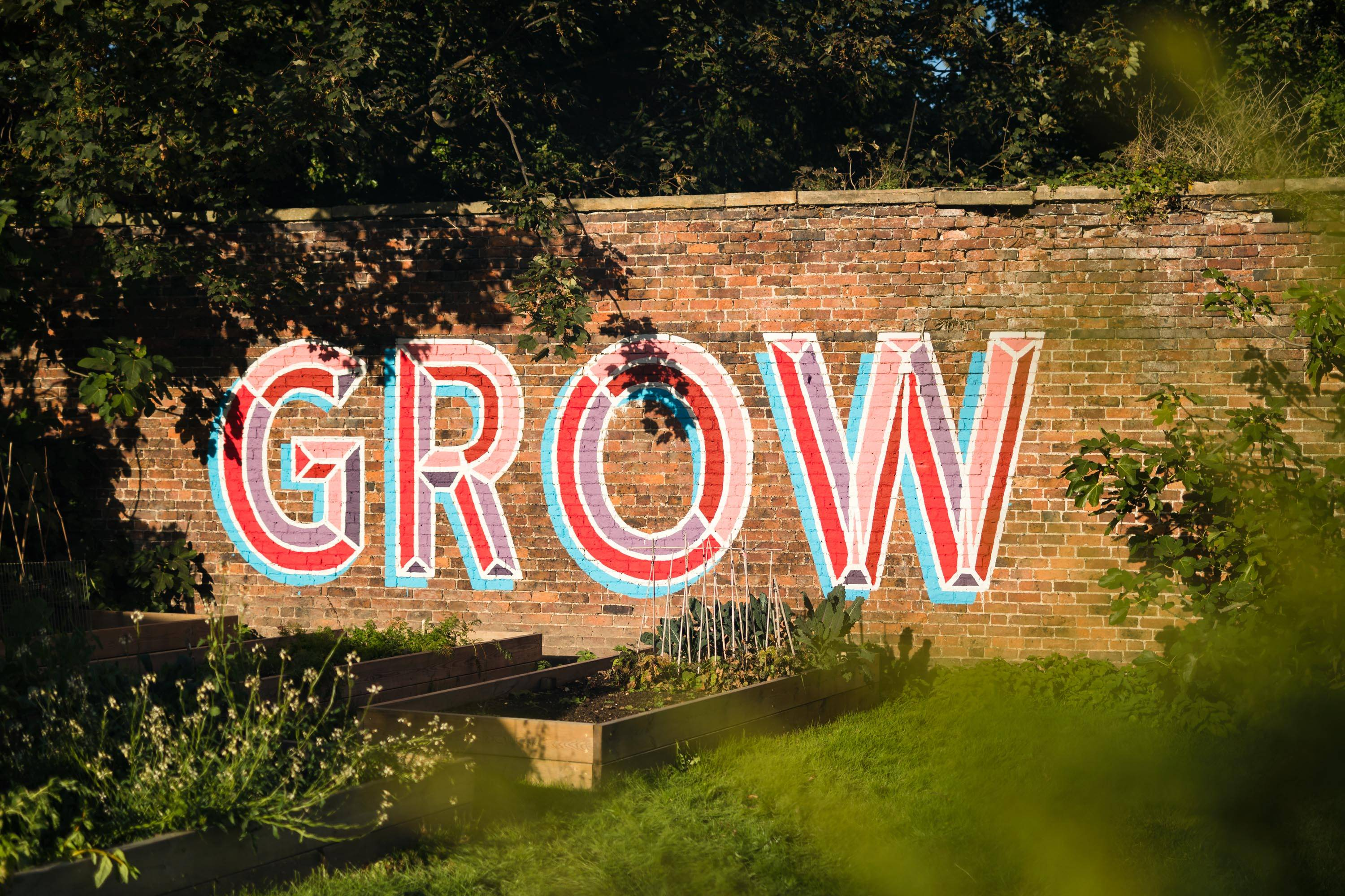 GROW art on veg garden wall at Hawarden Estate