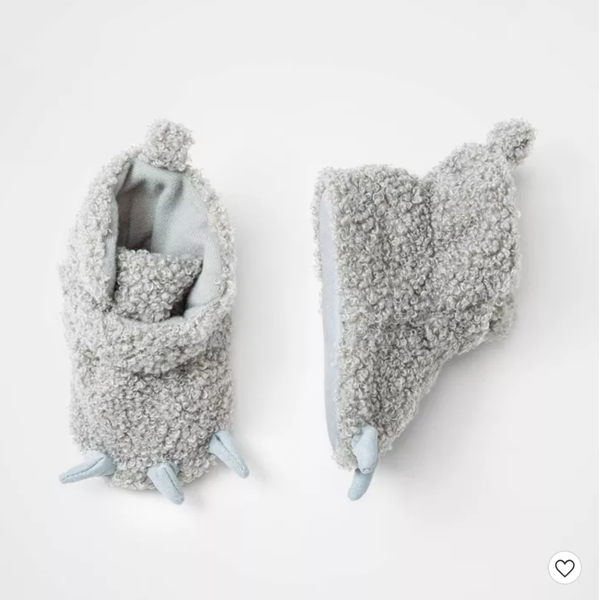 child with infant boy slippers
