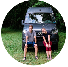 A young man and woman sit in front of a Mercedes Sprinter van with Flarespace flares