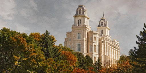 Manti Temple with autumn trees in the foreground.