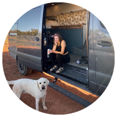 A woman and a dog sit in the open doorway of a Mercedes Sprinter van with Flarespace flares