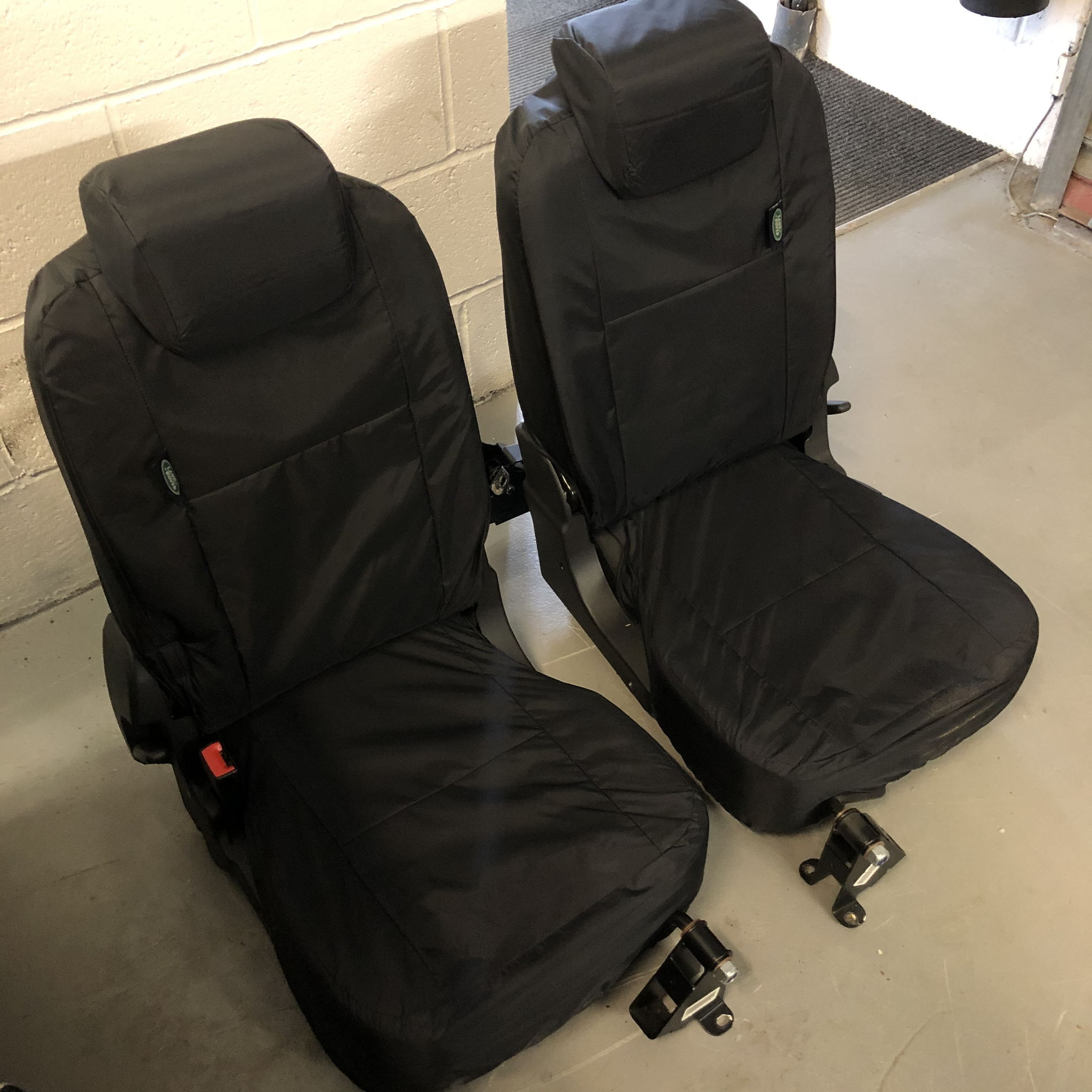 Genuine Land Rover Defender County Lock and Fold Seats's featured image