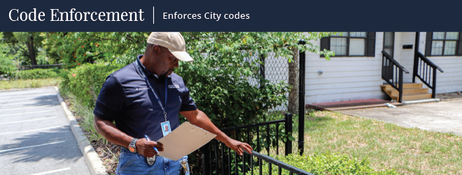 a dude inspects a nasty looking fence that has something suspicious smeared on it