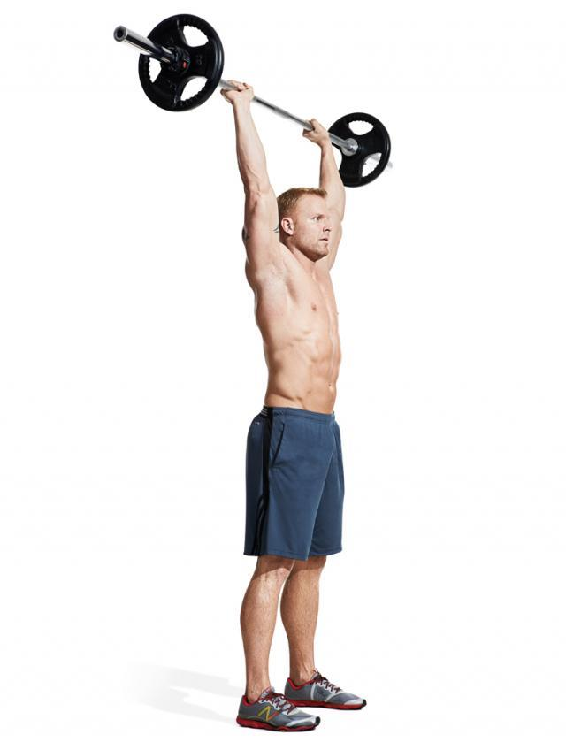 Hold the bar overhead and step forward with your left leg.