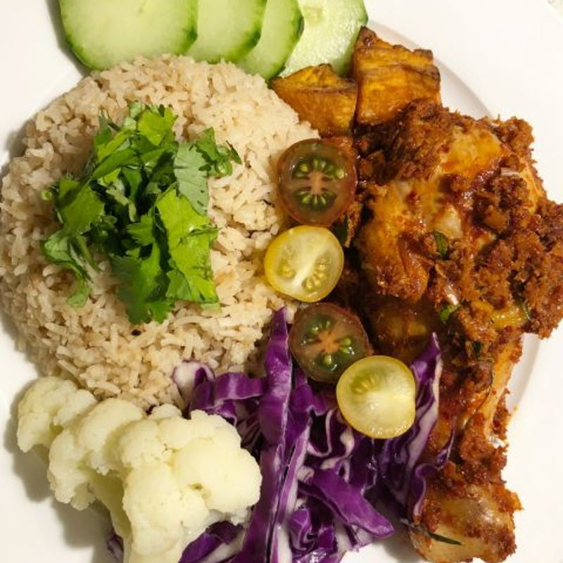 Chicken rendang served with lots of vegetables and rice ????????