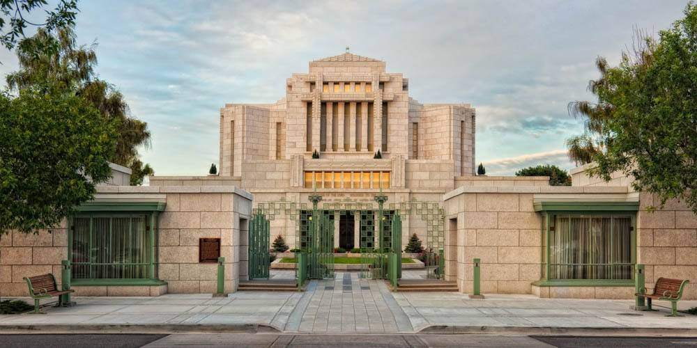 LDS art panoramic photo of the Cardston Temple focused on the green entrance gates.