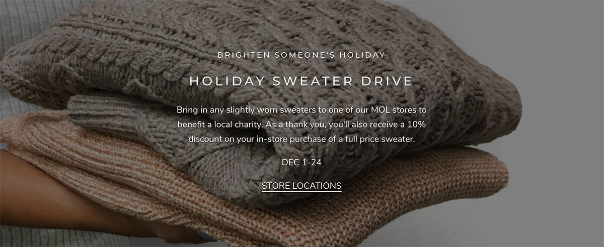 folded sweaters in hand with text describing the holiday sweater drive