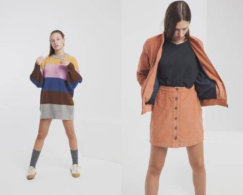 Woman wearing Thinking Mu sustainable oversized striped knit and woman wearing organic cotton rust coloured corduroy jacket and button up skirt combo