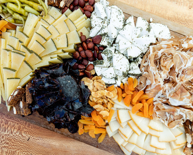A complete farm-to-table charcuterie board spread