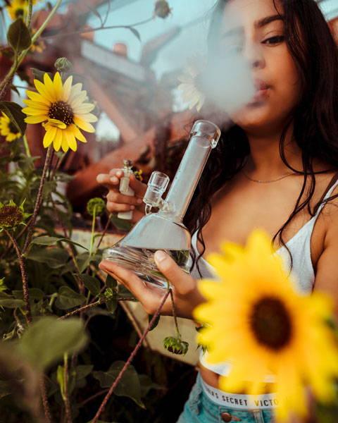 Woman smoking THC Cannabis, not CBD or Cannabidiol