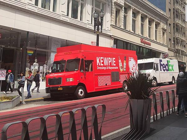 Kewpie truck parked next to FedEx Truck