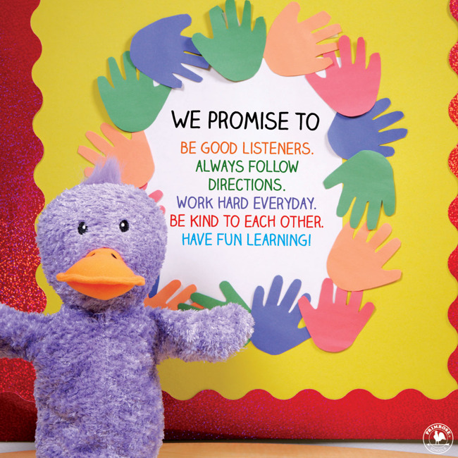 Primrose puppet Billy the duck stands next to the promise board