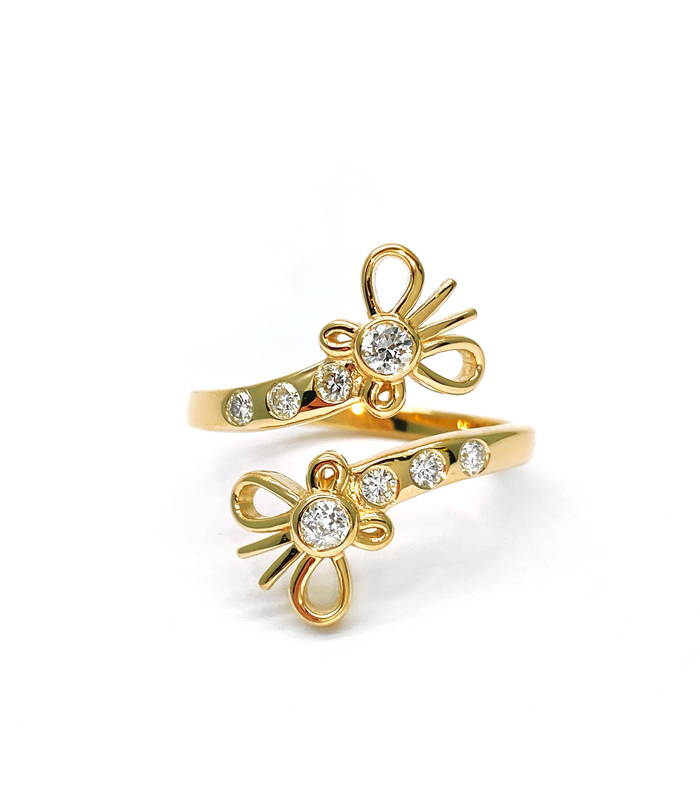 Yellow gold ring with split body ending in small butterflies with 4 small diamonds at each end.