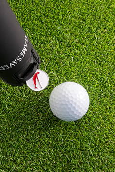 The GameSaver golf putter grip puts down ball markers