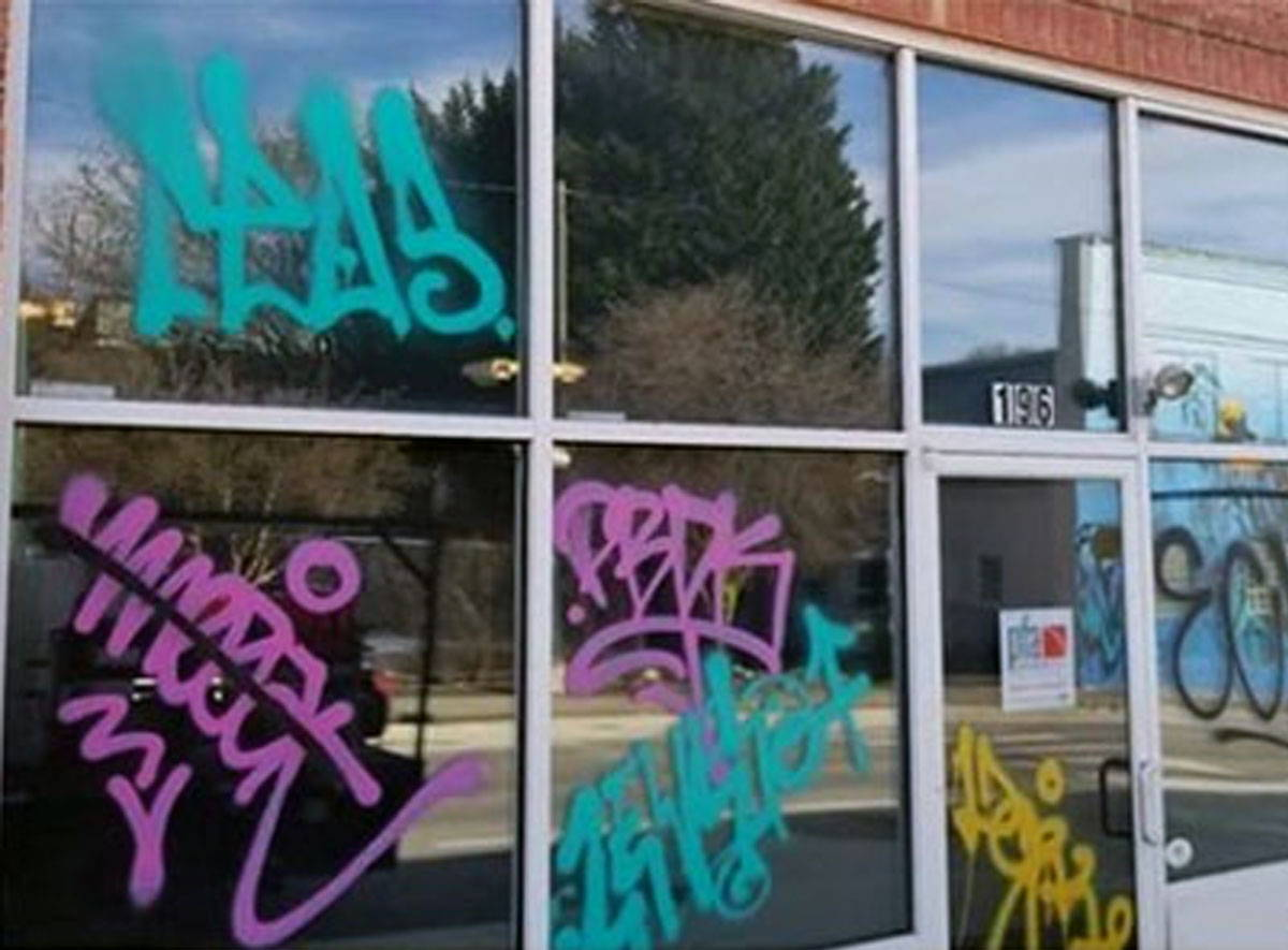 graffiti removal from glass and metal frames
