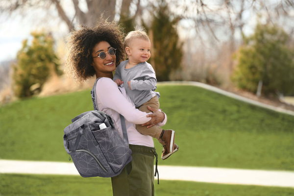 child with wide frame diaper bag backpack