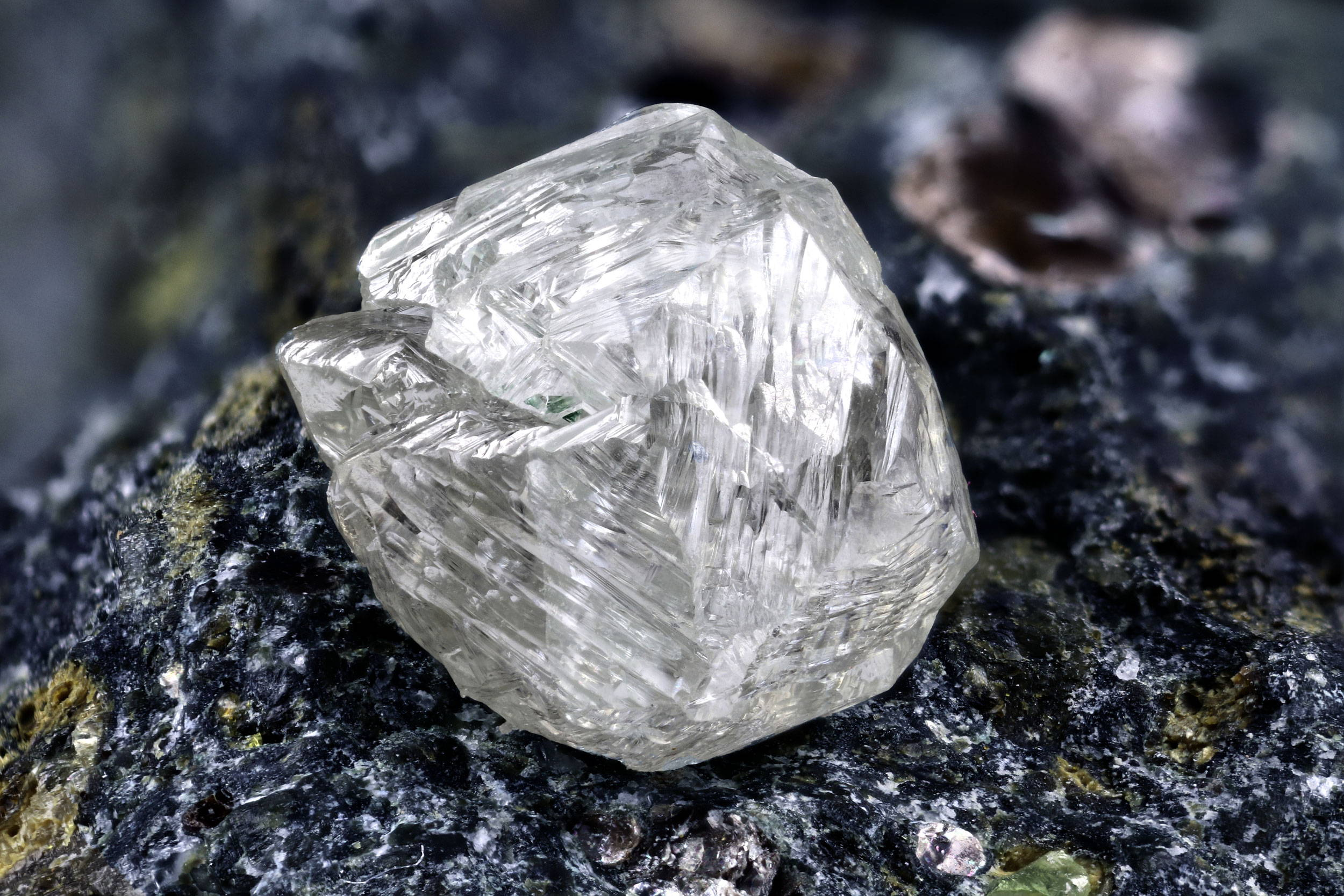 Rough diamond fresh from the mine, sitting on kimberlite. Canadian diamonds  available at K8 Jewelry Concepts Bijoux Montreal.