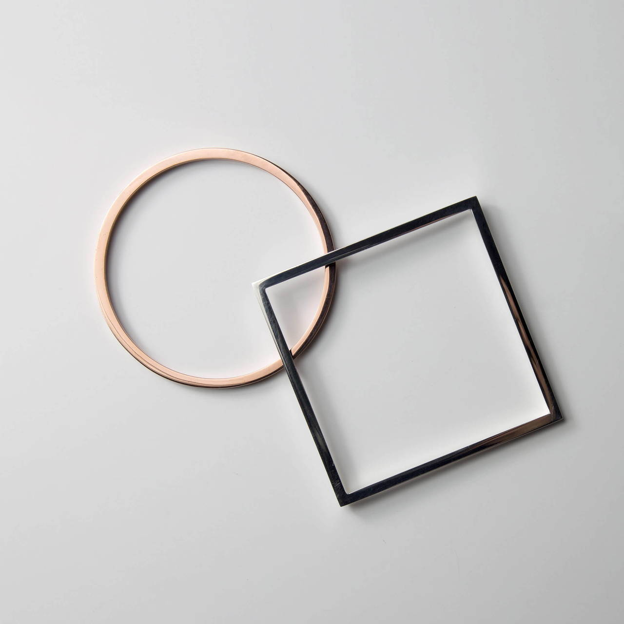 Round Bangle in Copper with Square Bangle in Silverging