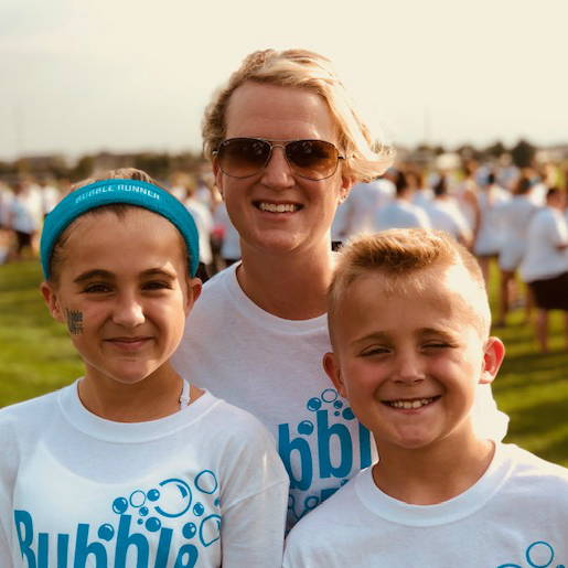 A photo of our March 2019 Hero, Rachael Masters, with her two children.