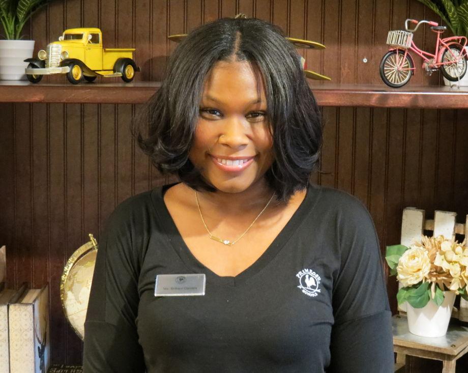 Brittani Daniels , Assistant Director