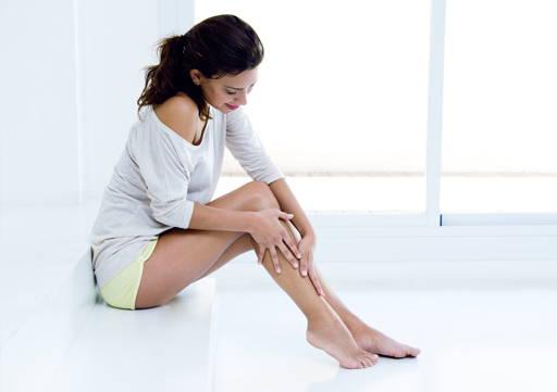 Woman creaming body