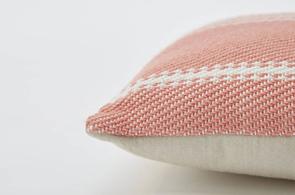 Close up of the Oxford Stripe Coral Cushion