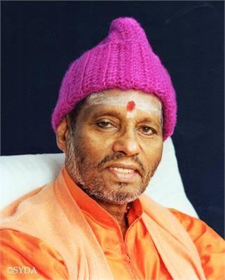Baba Muktananda portrait with orange shawl and pink hat