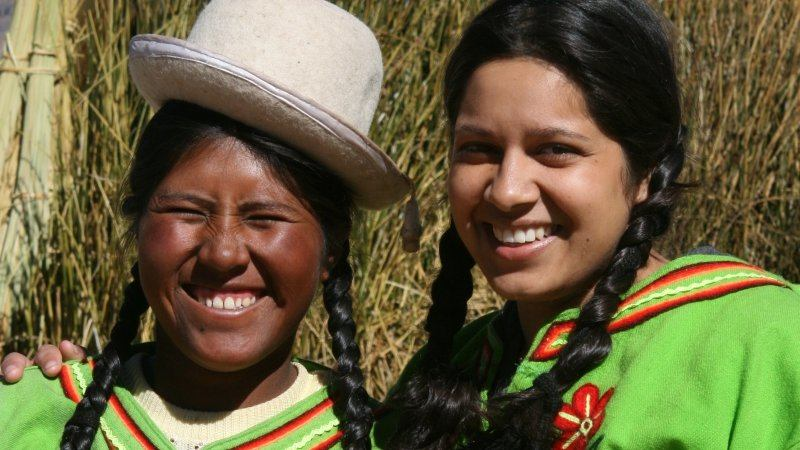 Friendly Uros Indian ladies on Lake Titicacas Reed, Peru