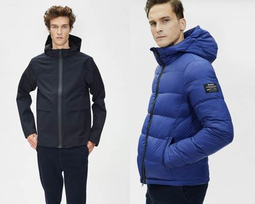 Man wearing dark navy waterproof recycled polyester coat from eco-brand Ecoalf and man wearing royal blue padded insulated sustainable jacket from Ecoalf