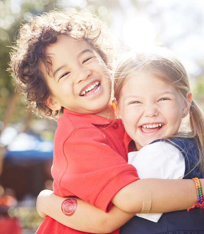 children smiling and hugging