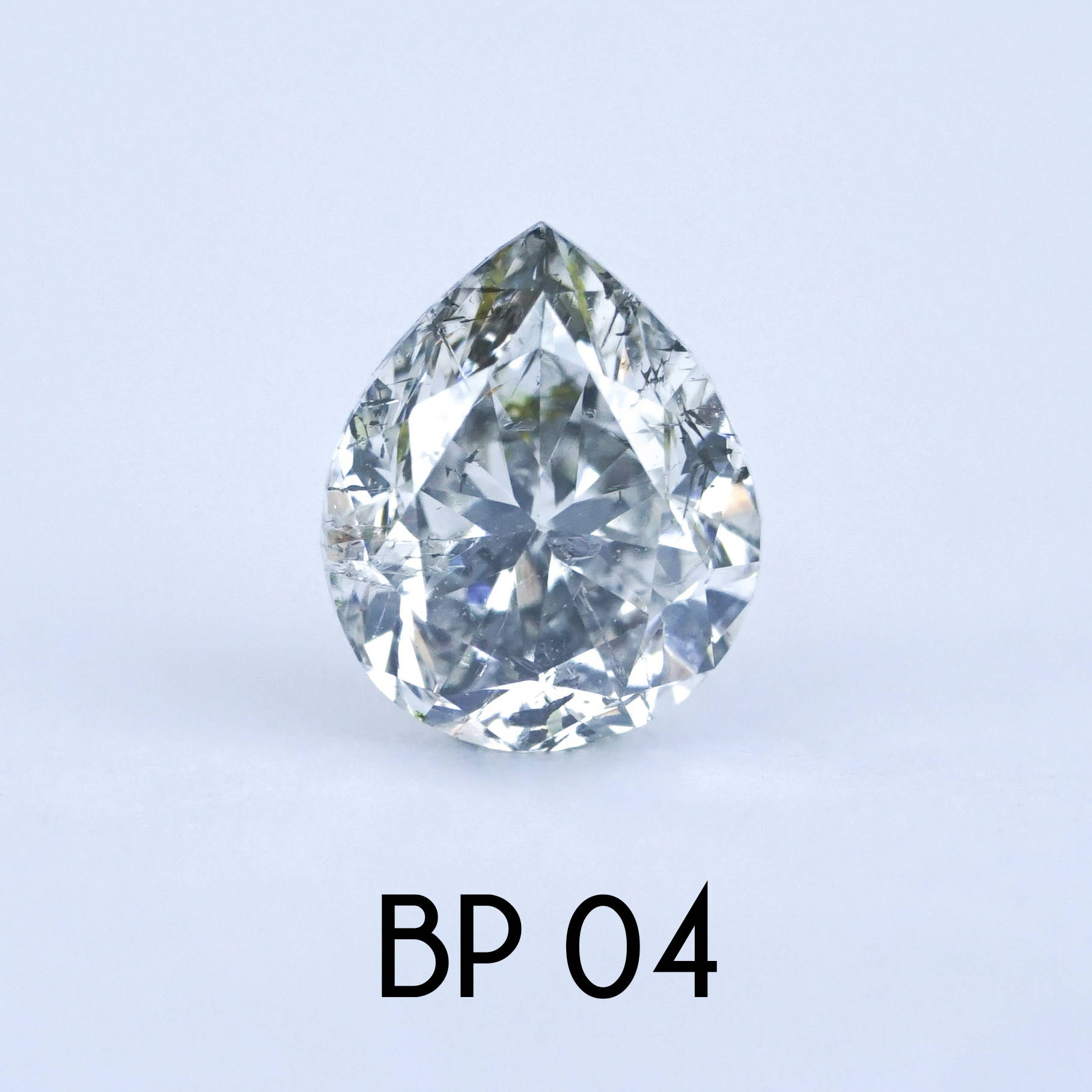 A custom brilliant cut pear diamond for a custom ethical gold ring.
