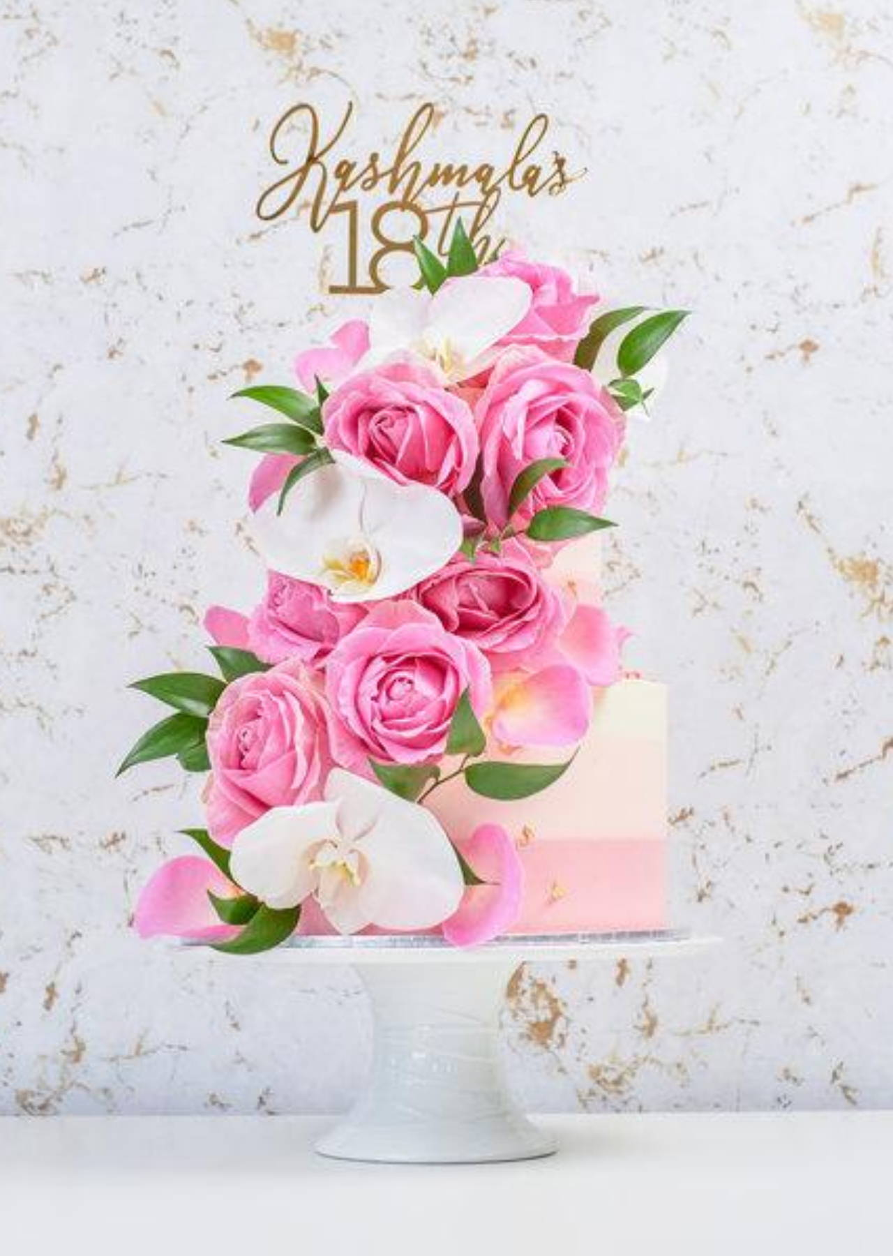 2 Tier Birthday Cake with Pink Florals, White Orchids and Green Foliage